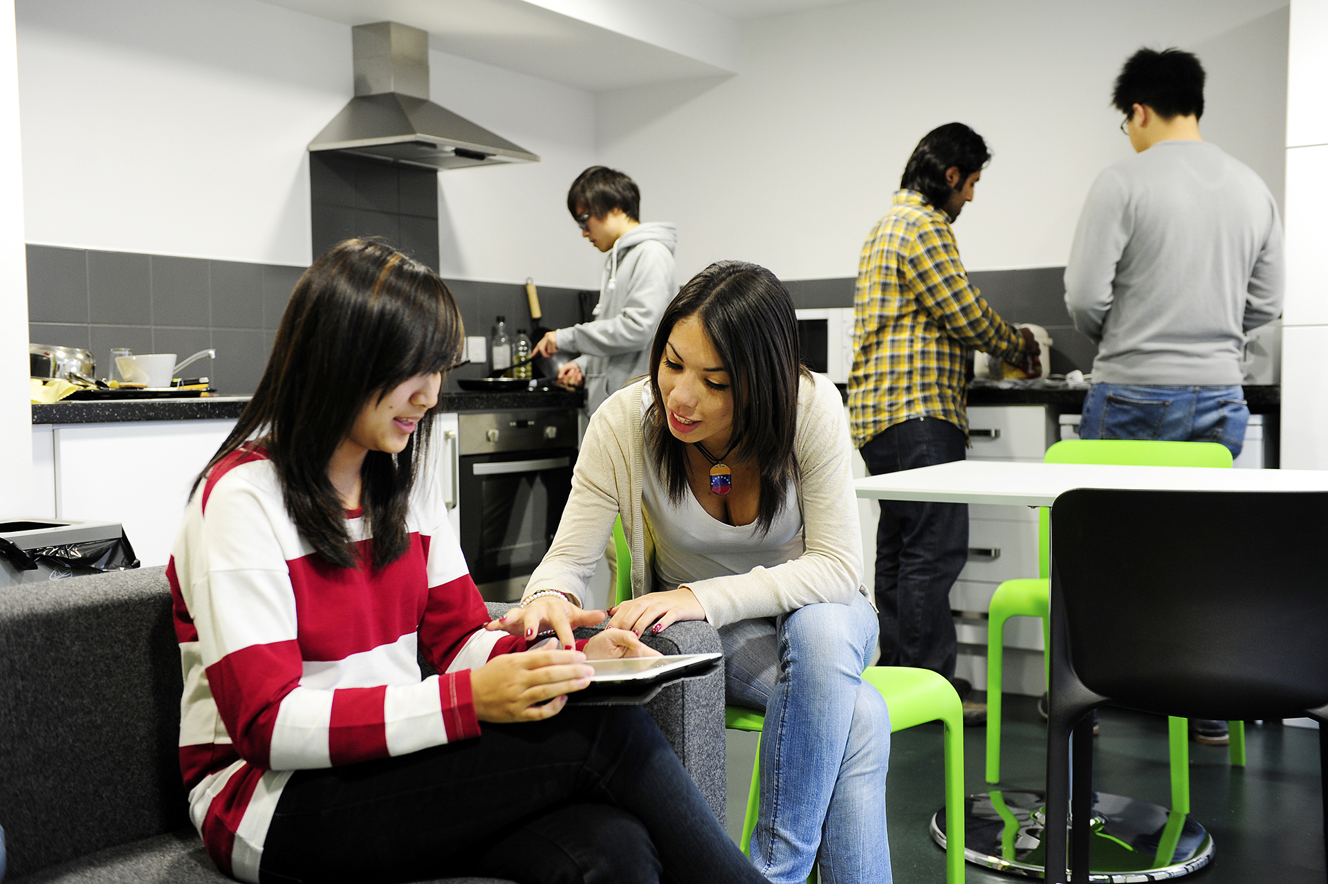 International students socialising in shared communal area at INTO NCL student residences building