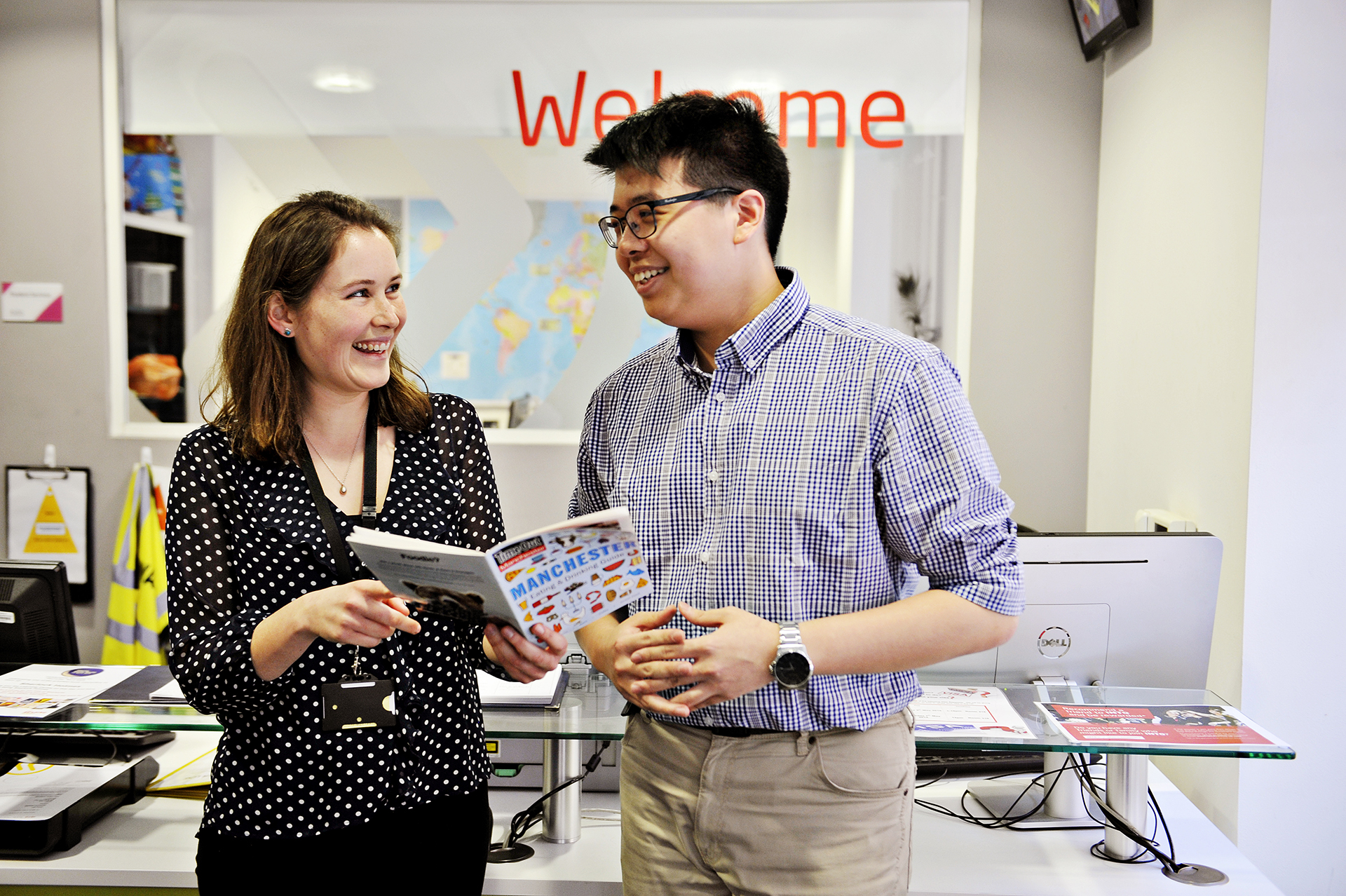 The INTO Manchester welcome desk provides support to students