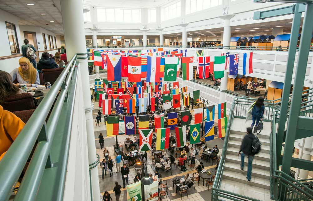 International flags from different countries fly at George Mason University
