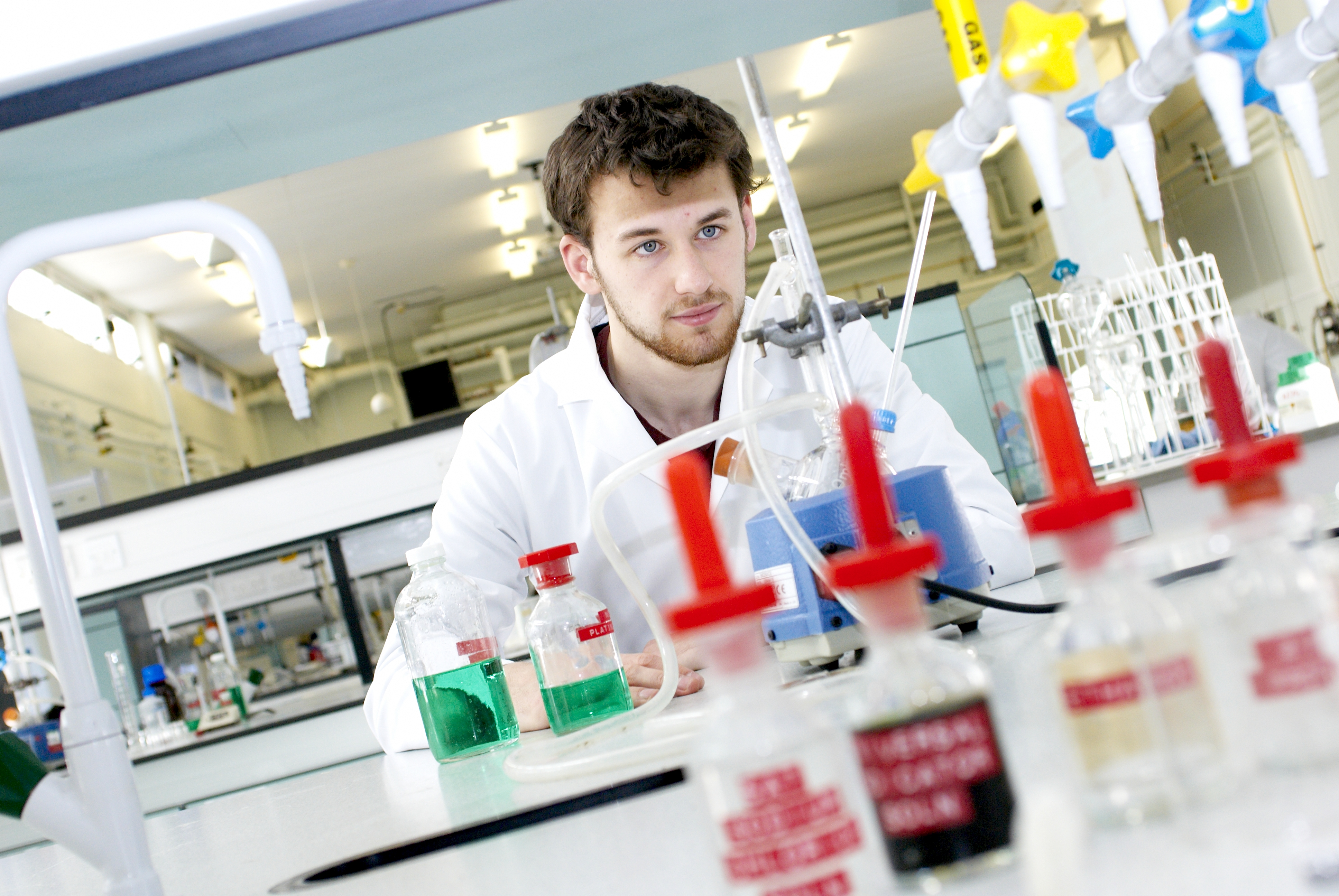 Student working in pharmacy laboratory with science equipment