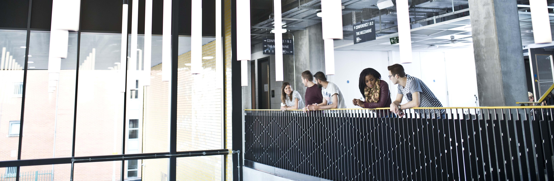 Student socialising on a mezzanine at Manchester Metropolitan University