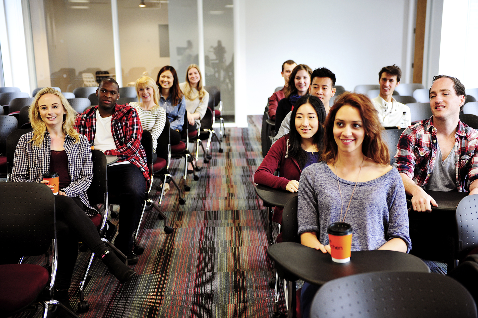 Students in a conference room for a lecture on law