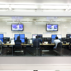 Large Bloomberg computer screens as part of financial risk management