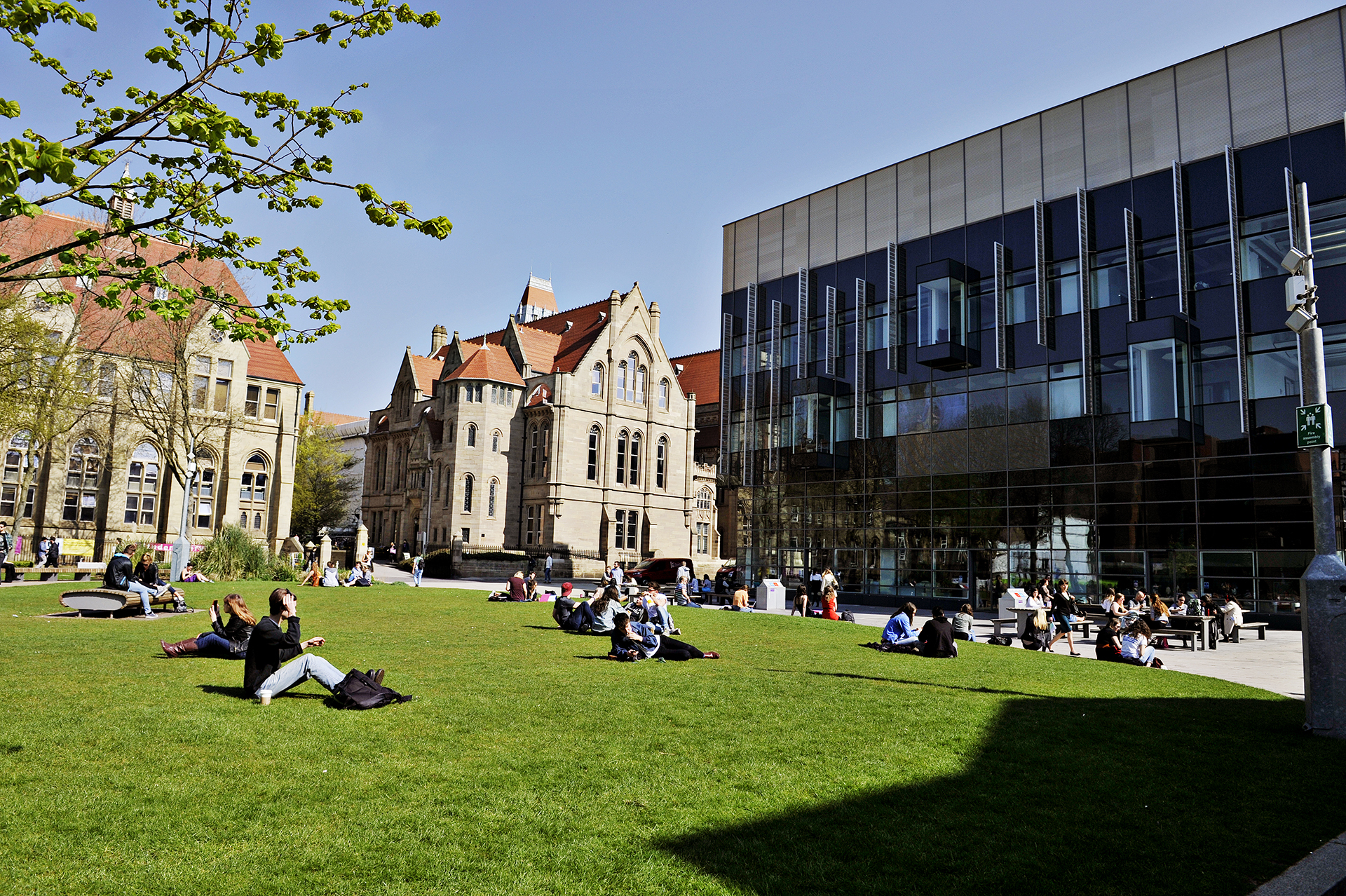 Students sitting outside of The University of Manchester