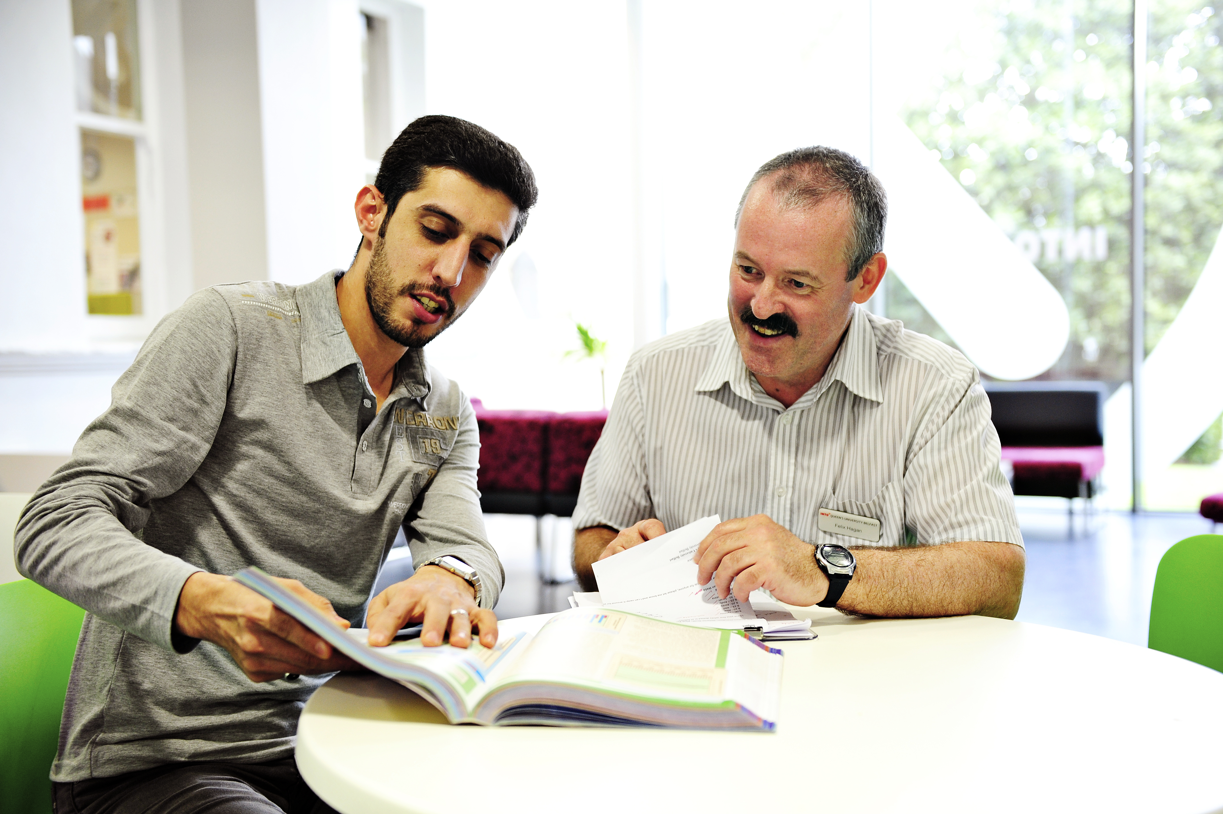 INTO QUB teacher helping student