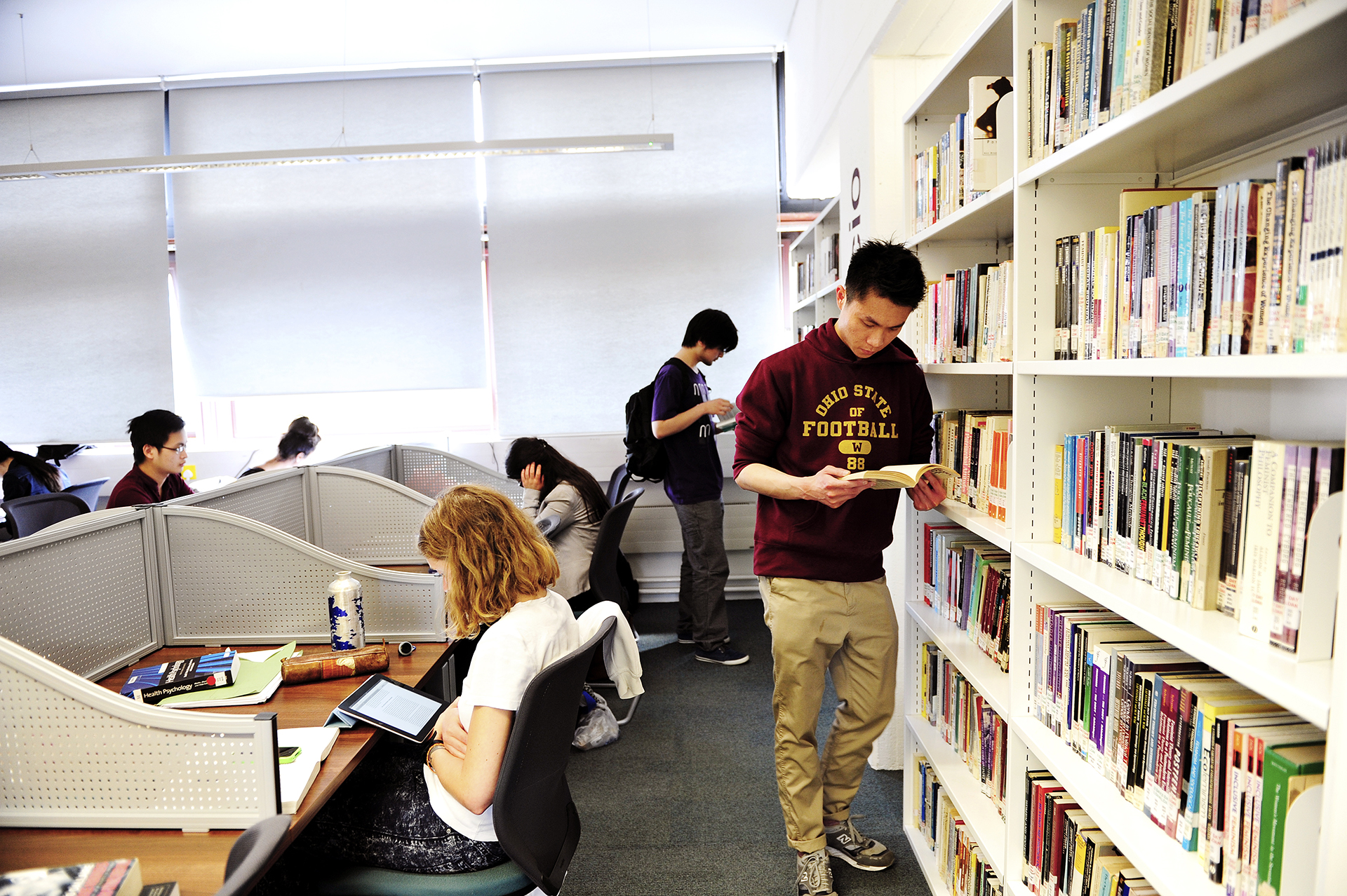 Students reading books and studying in City, University of London library