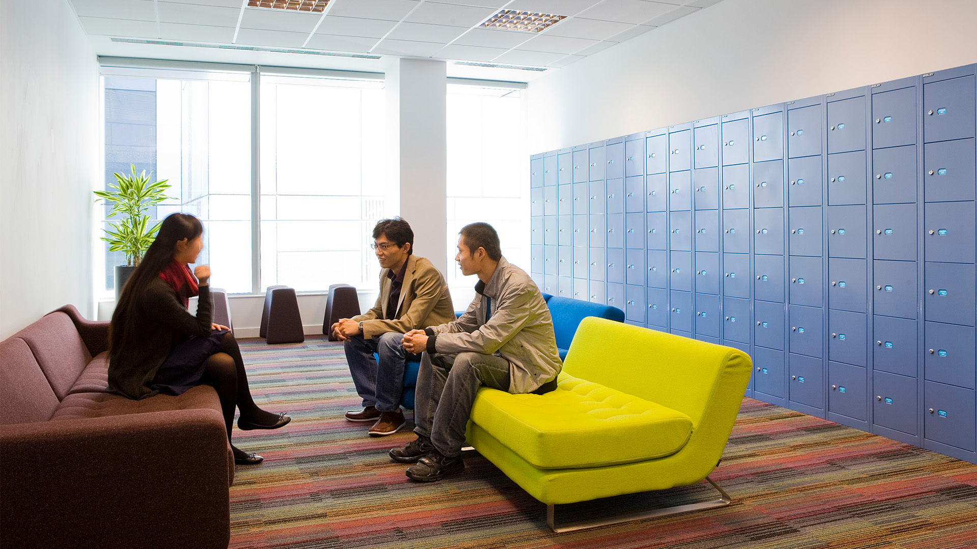 Student socialising in one of INTO London's many breakout areas