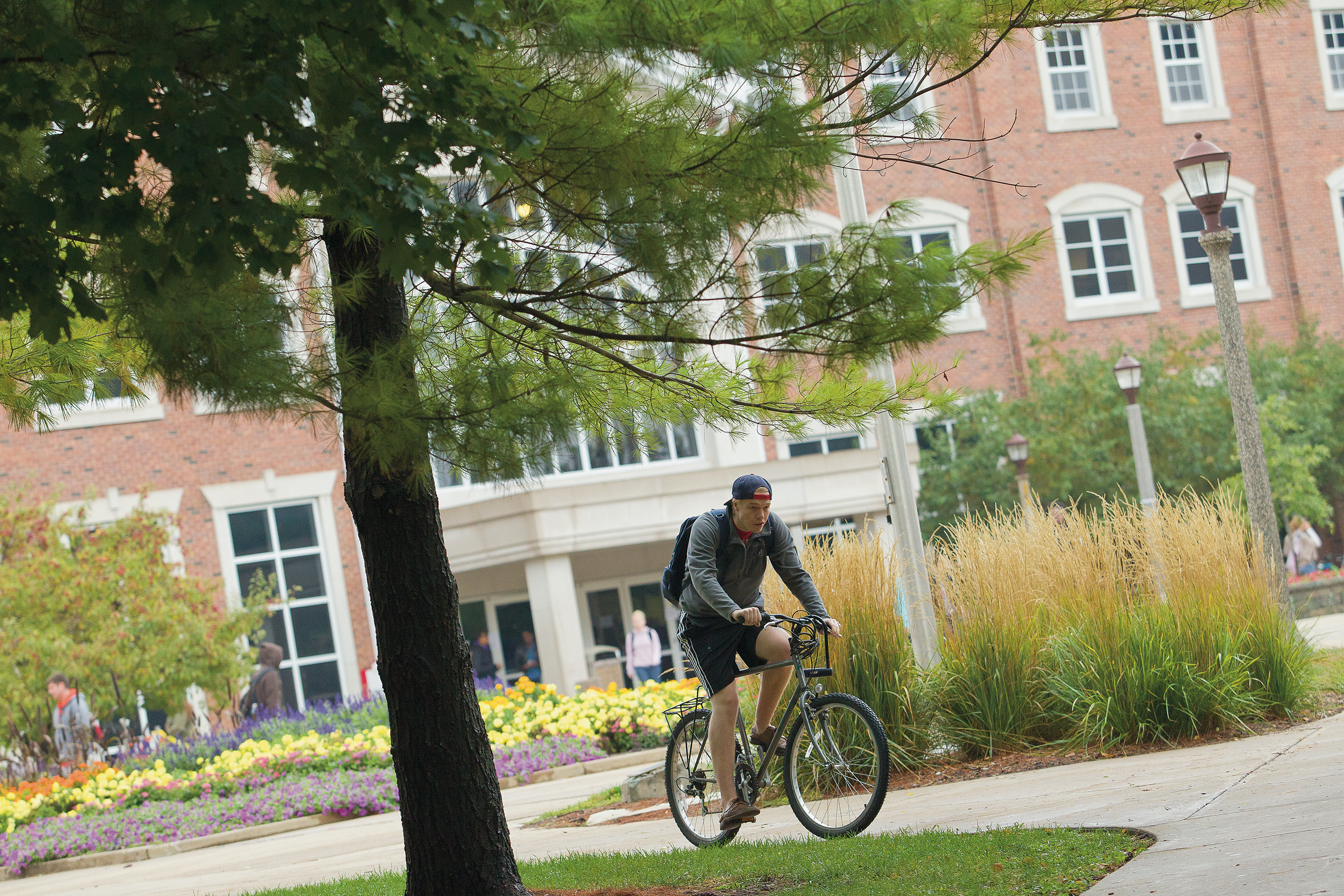 ISU male student on bicycle campus