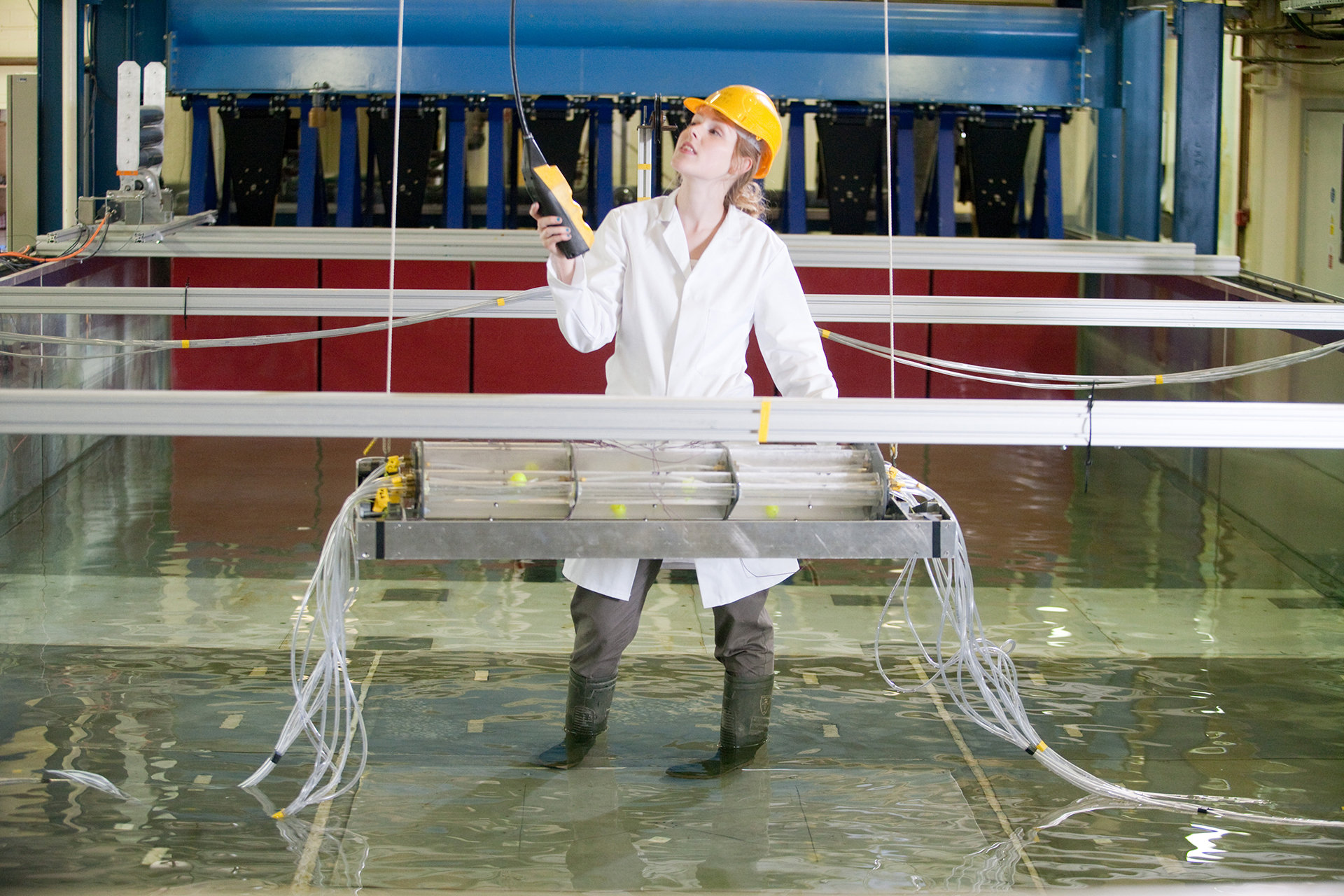 INTO student conducting tests in a water tank