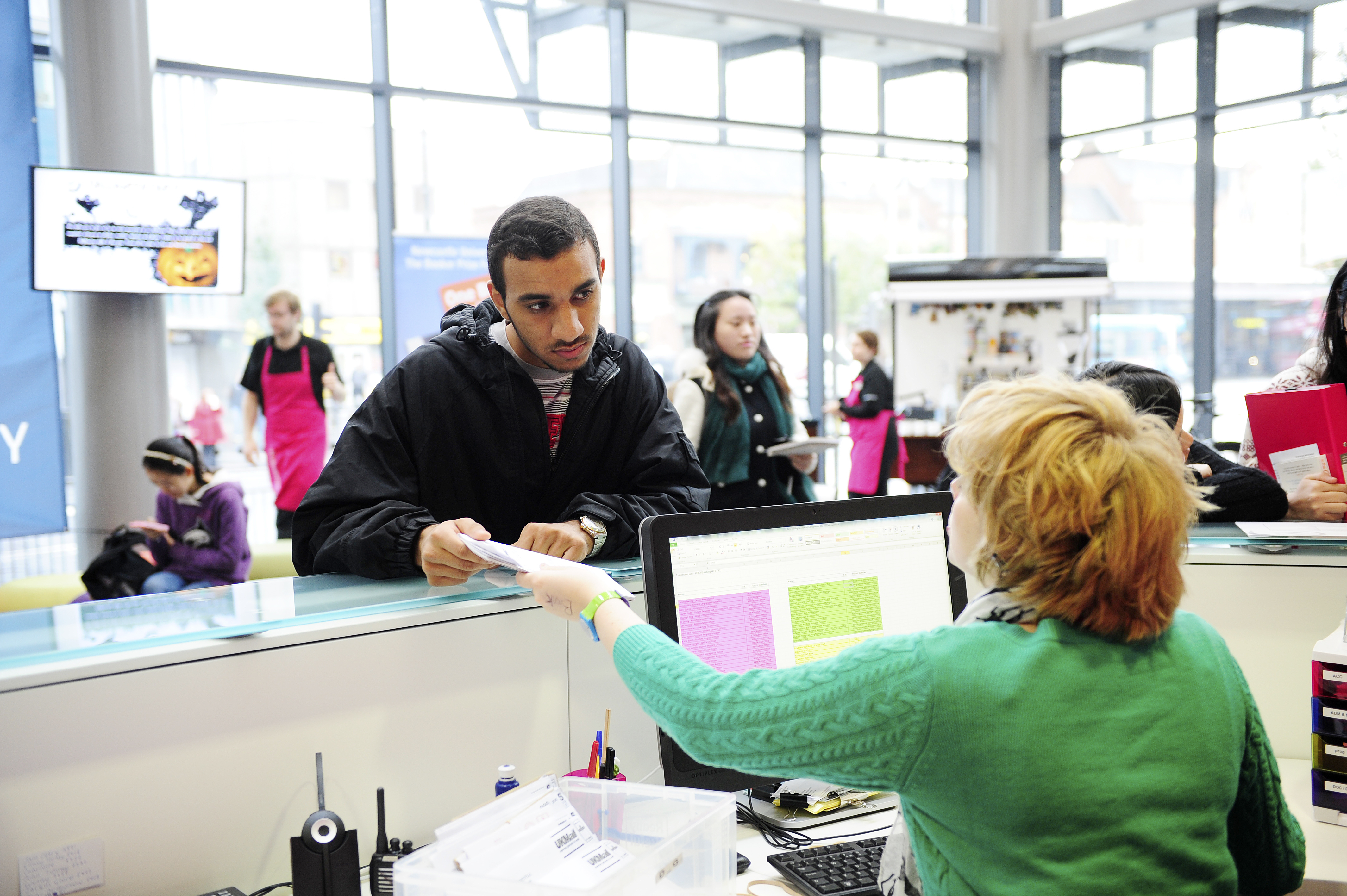 staff and students at welcome desk