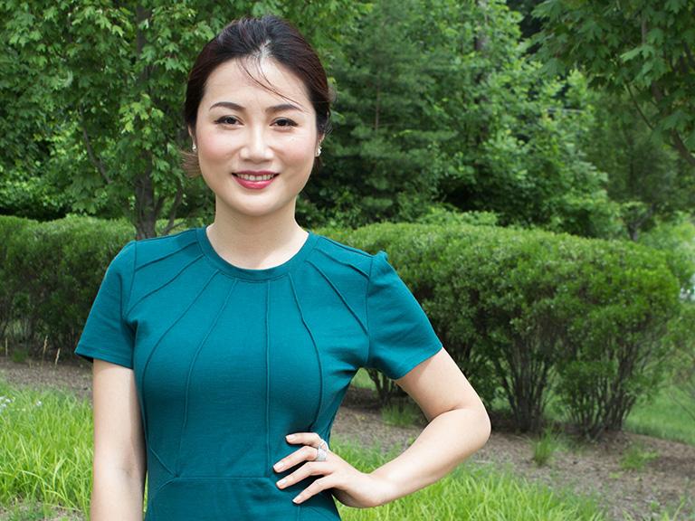 Mason female student posing for camera outdoors