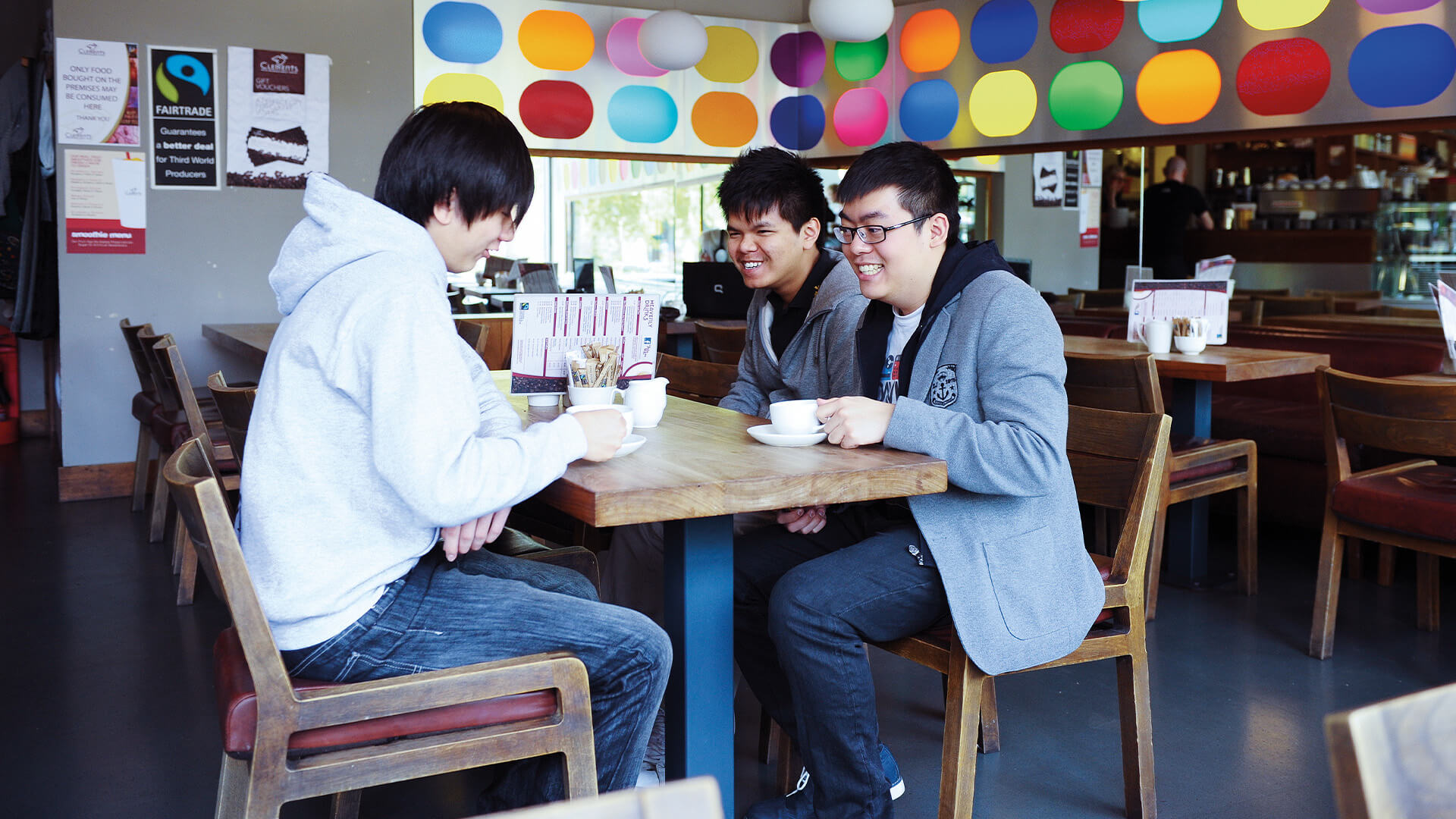 Students drinking coffee at Clements cafe on-campus at Queen's University Belfast