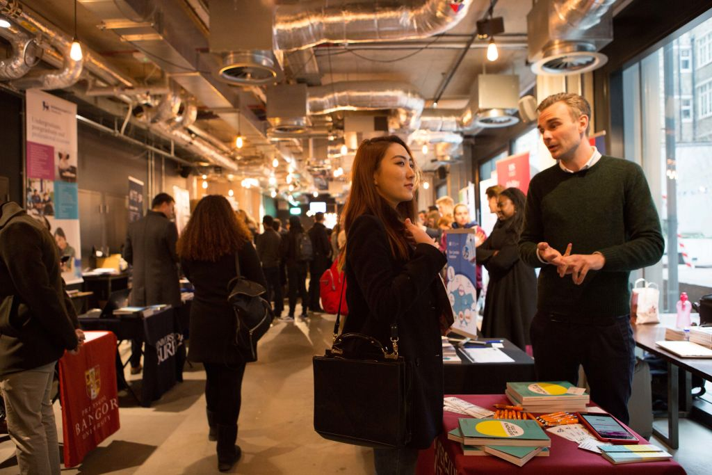 London Placement Fair - student talking to university representative