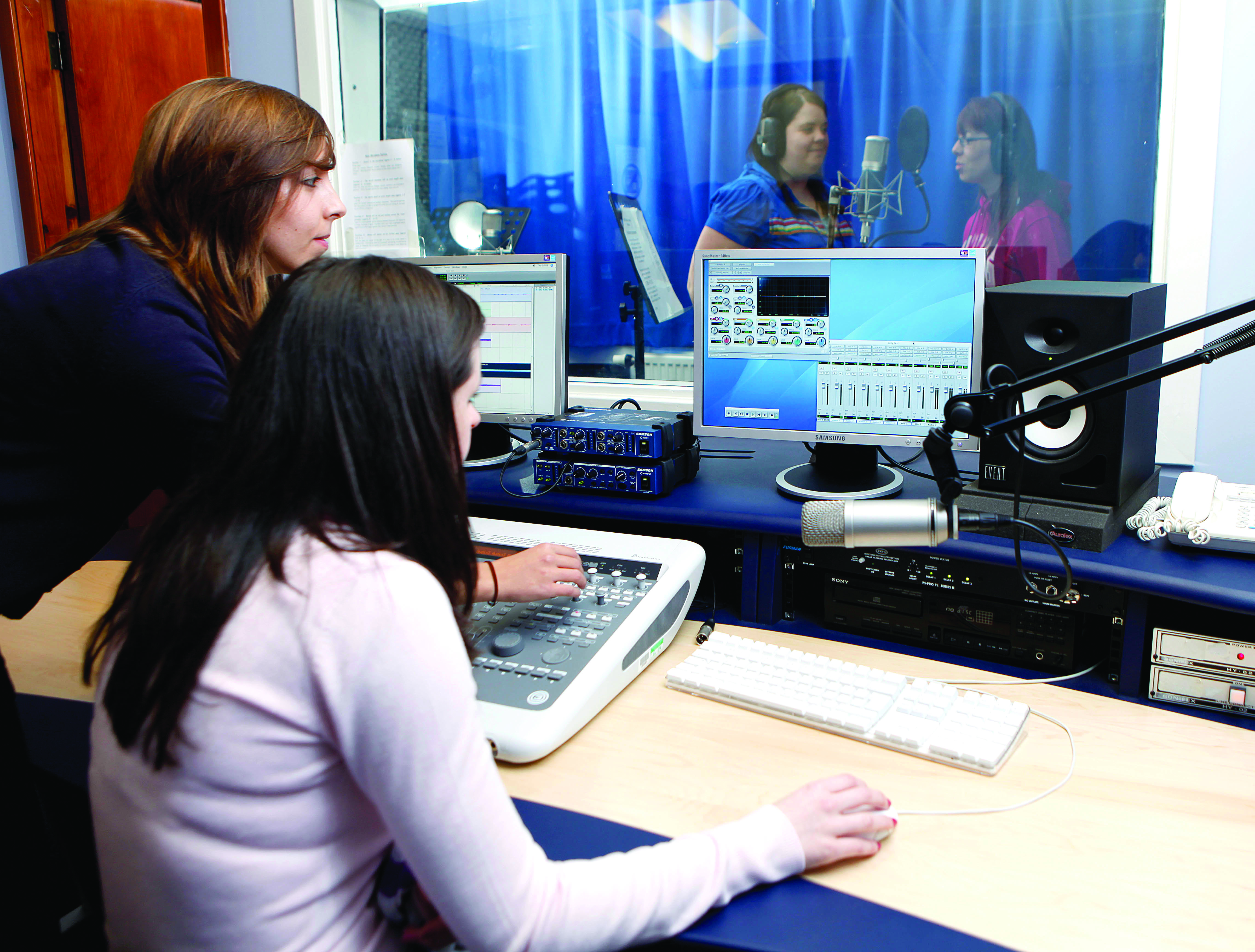 Group of students working in a sound studio