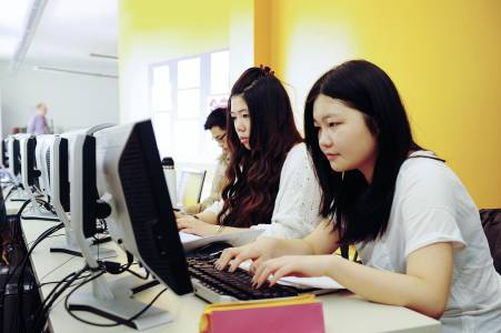 International students working at computers in the Learning Resource Centre