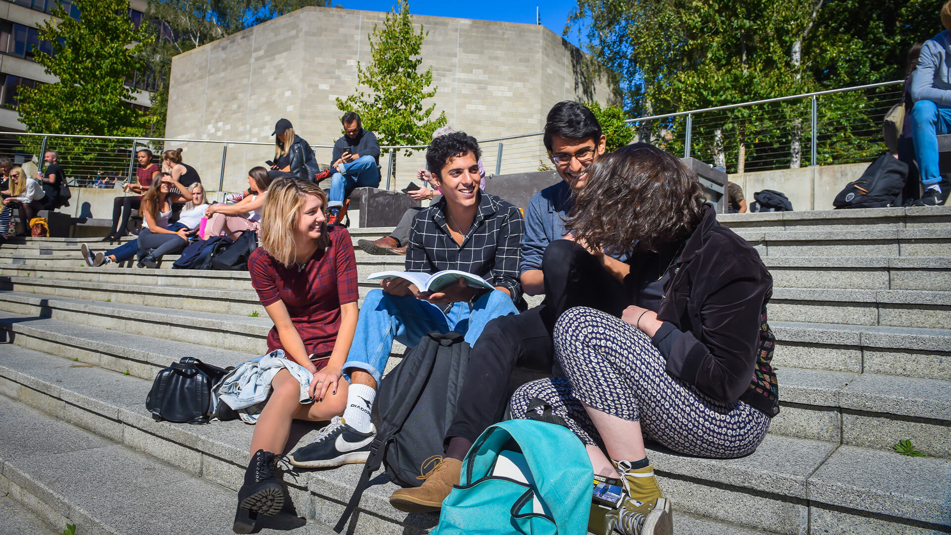 Photo of students studying outside at University of East Anglia campus