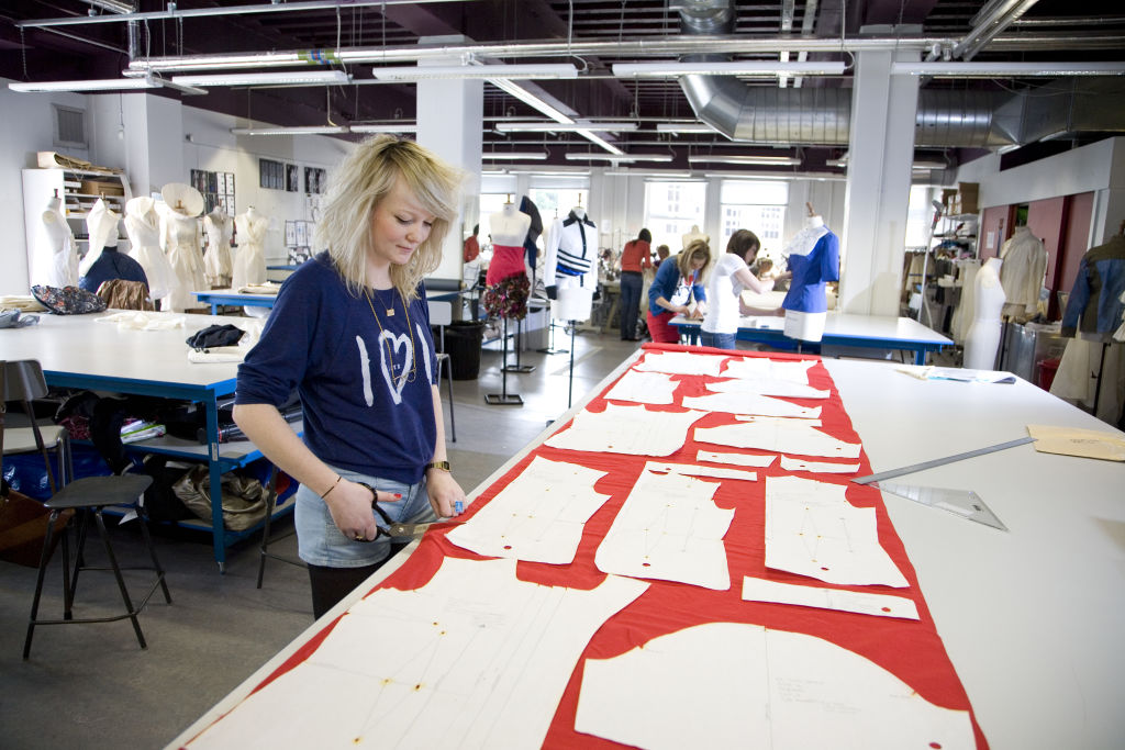 Fashion student drafting a pattern