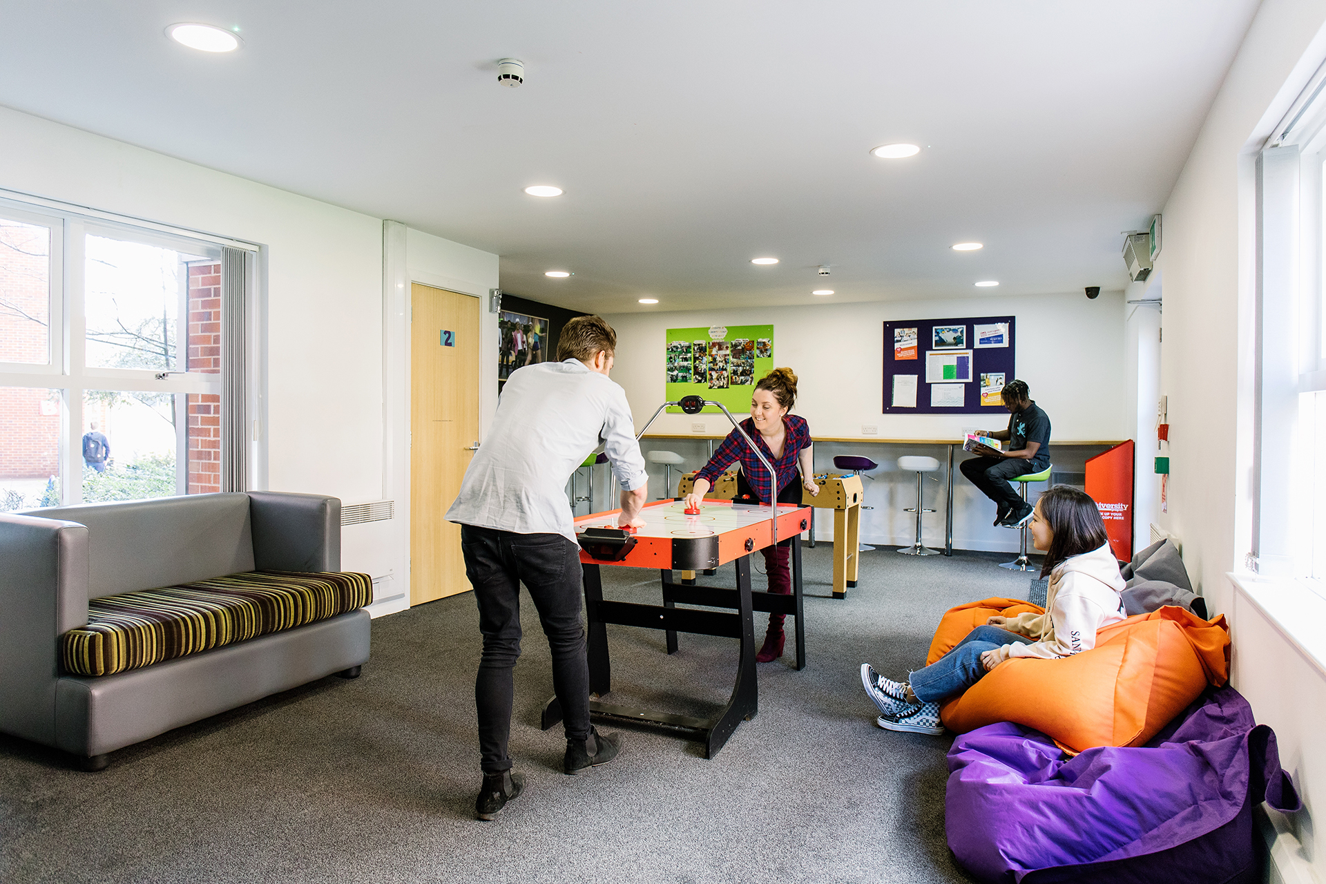 Students playing games in the social area