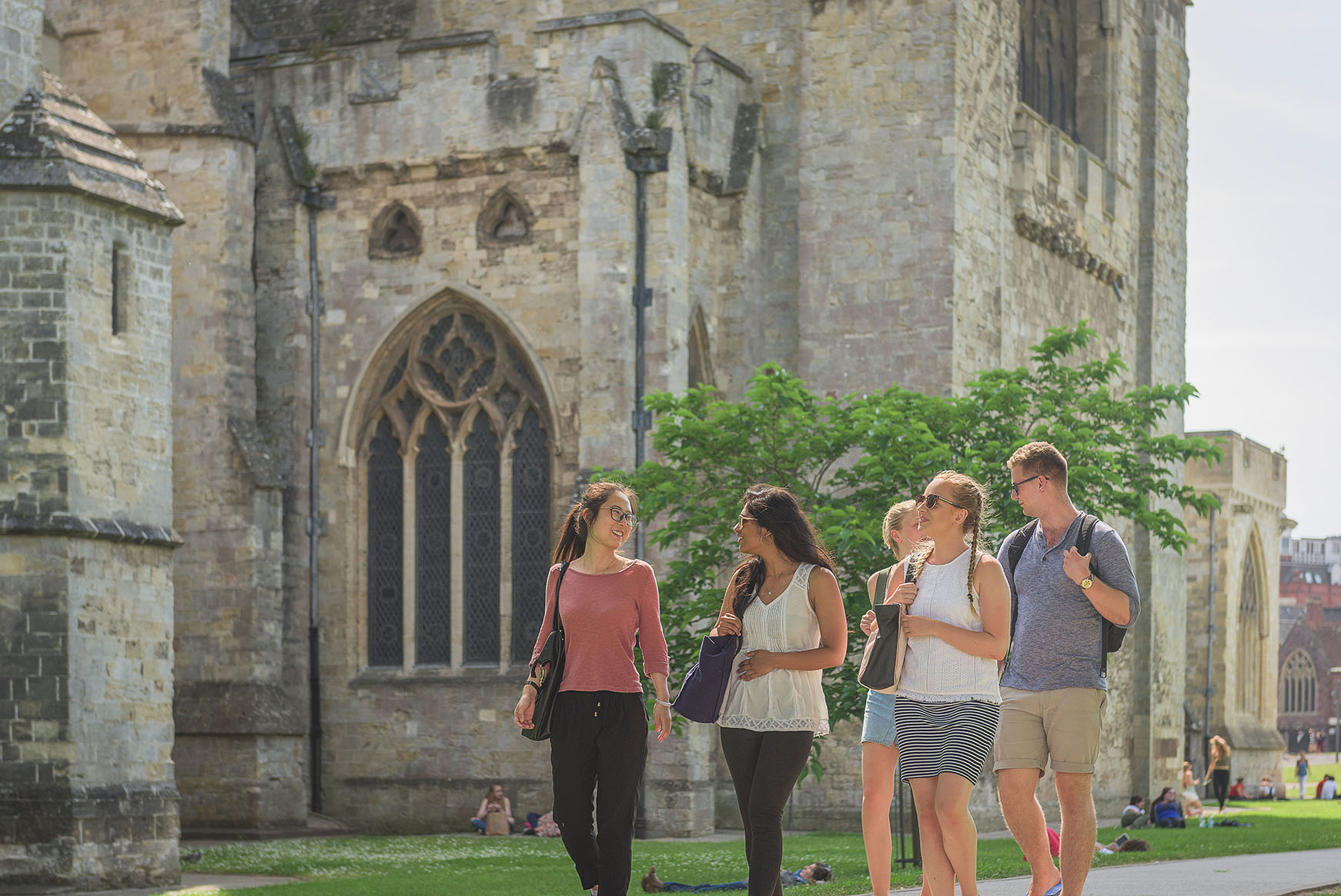 Students walking outside Exeter cathedral