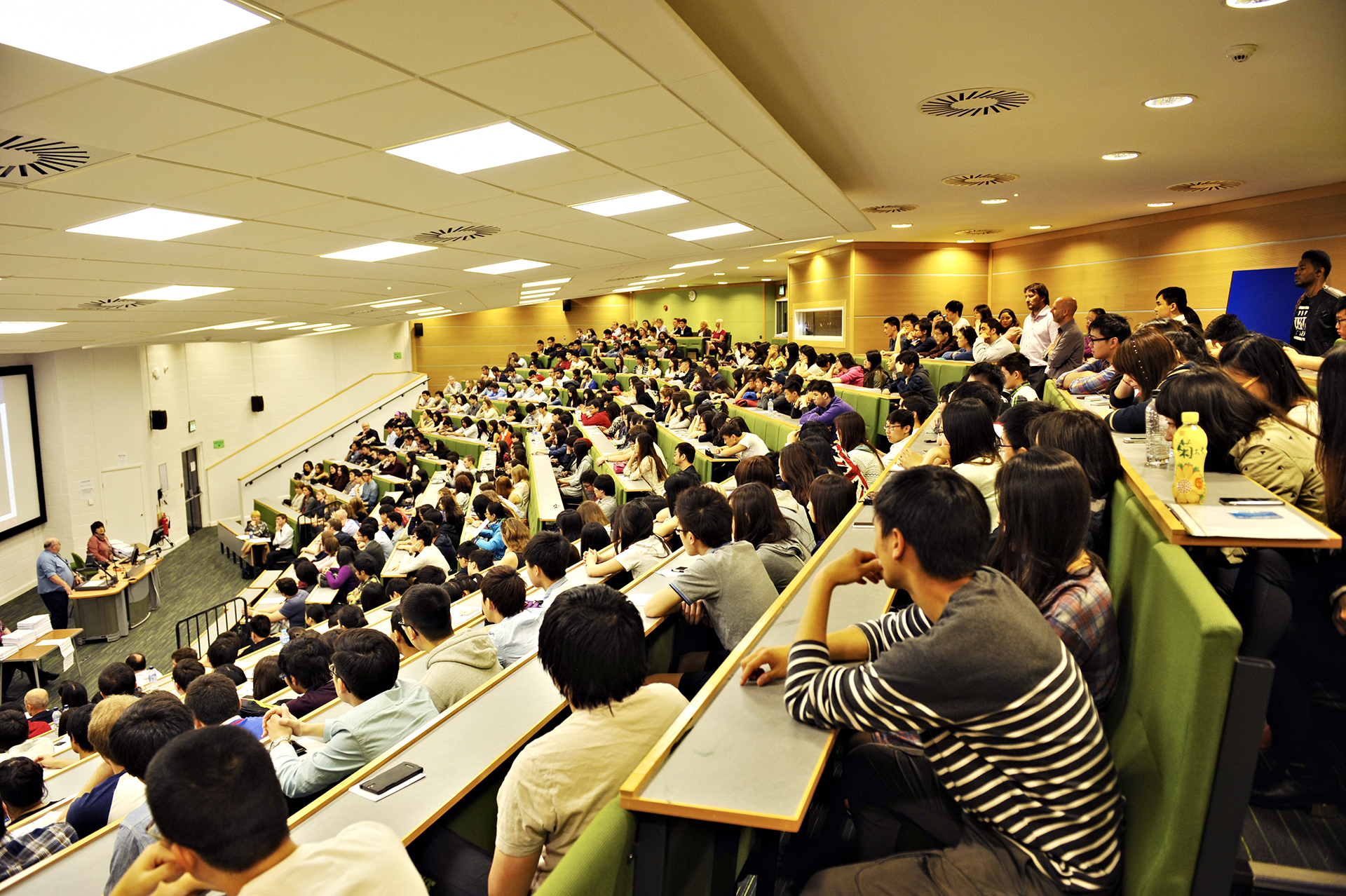 Students sat in large lecture hall for Economics and Finance