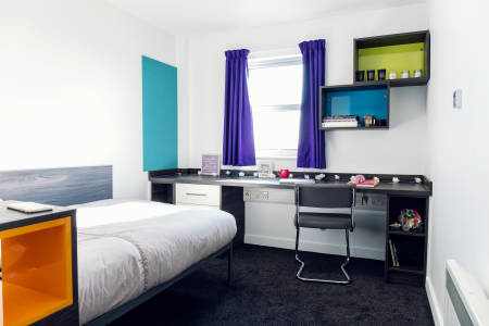 View of INTO Manchester Liberty Point en suite room with bed and desk