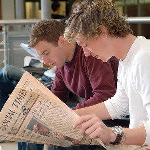 Student reads the Financial Times at University of Exeter