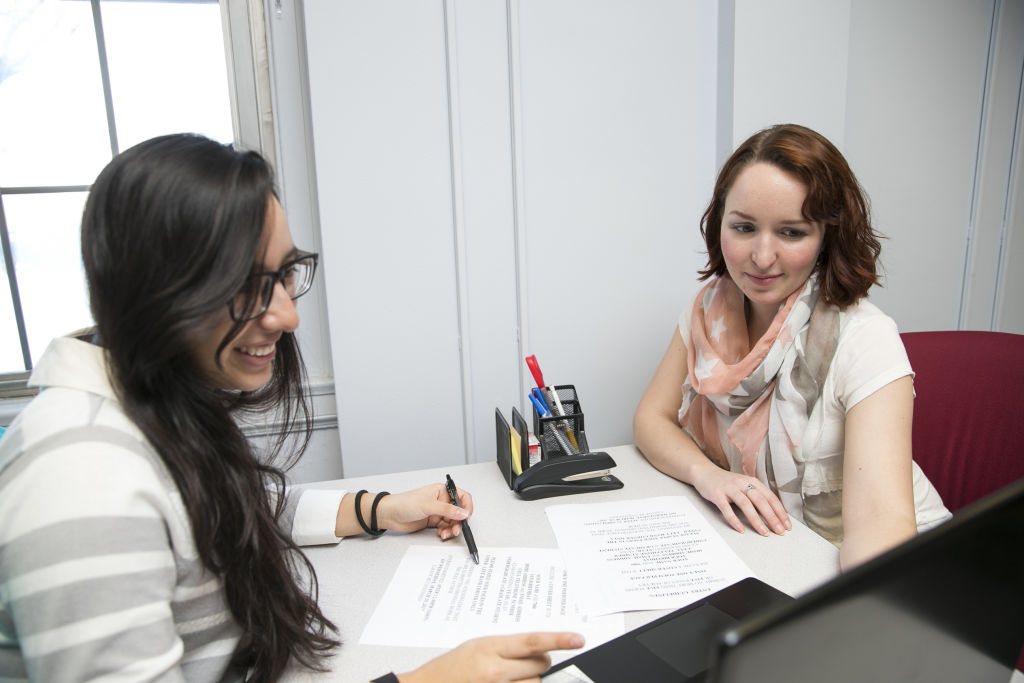 INTO staff work closely with students on class assignments