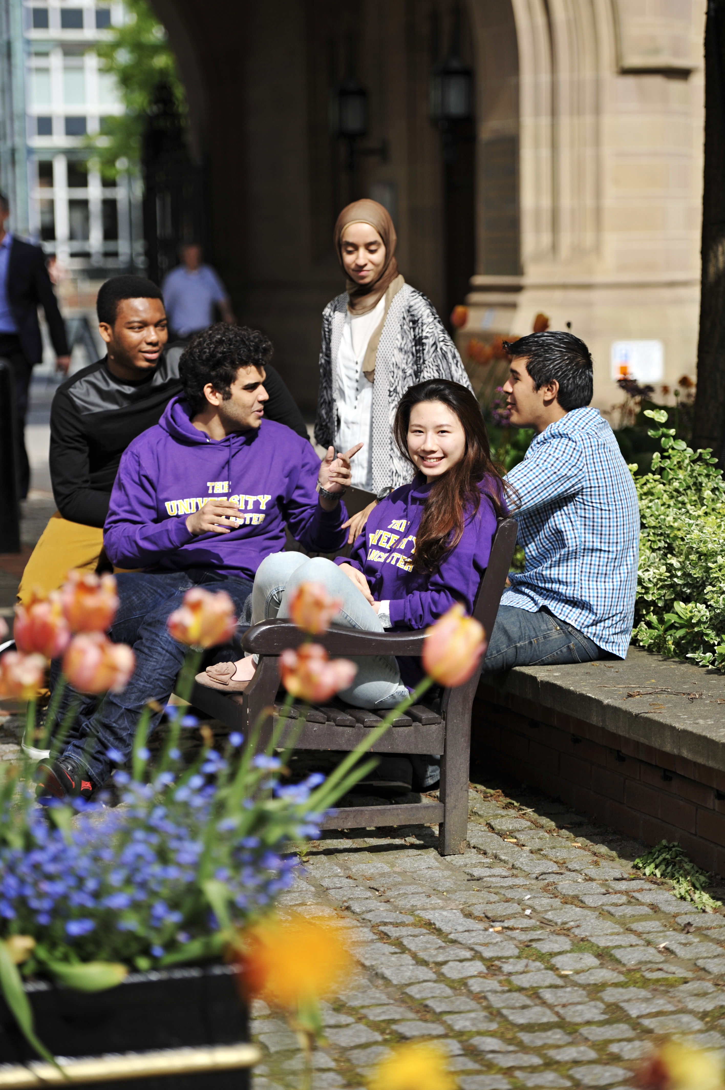 Student socialising outside on campus at The University of Manchester