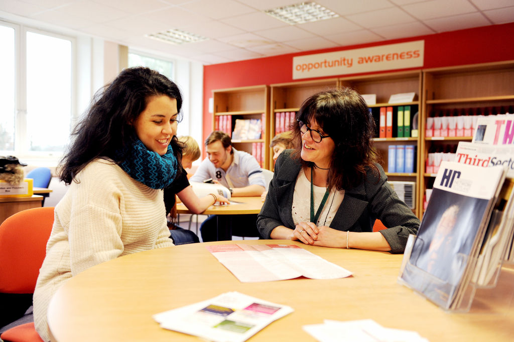 Student talking with member of staff