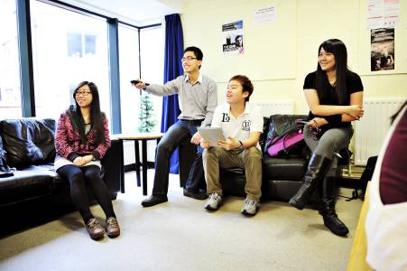 International students socialising in the lounge area in Willow Walk student residences