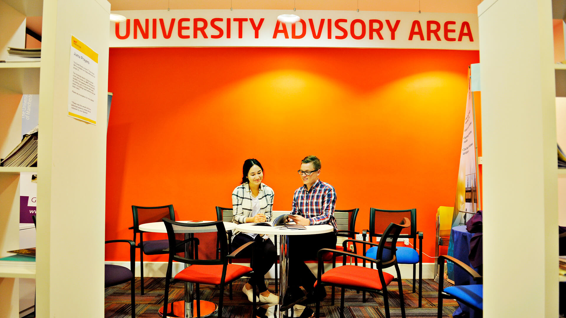 International student getting advice from a teacher in the INTO Manchester university advisory area