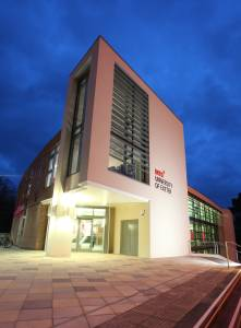 External view of University of Exeter INTO Centre in evening