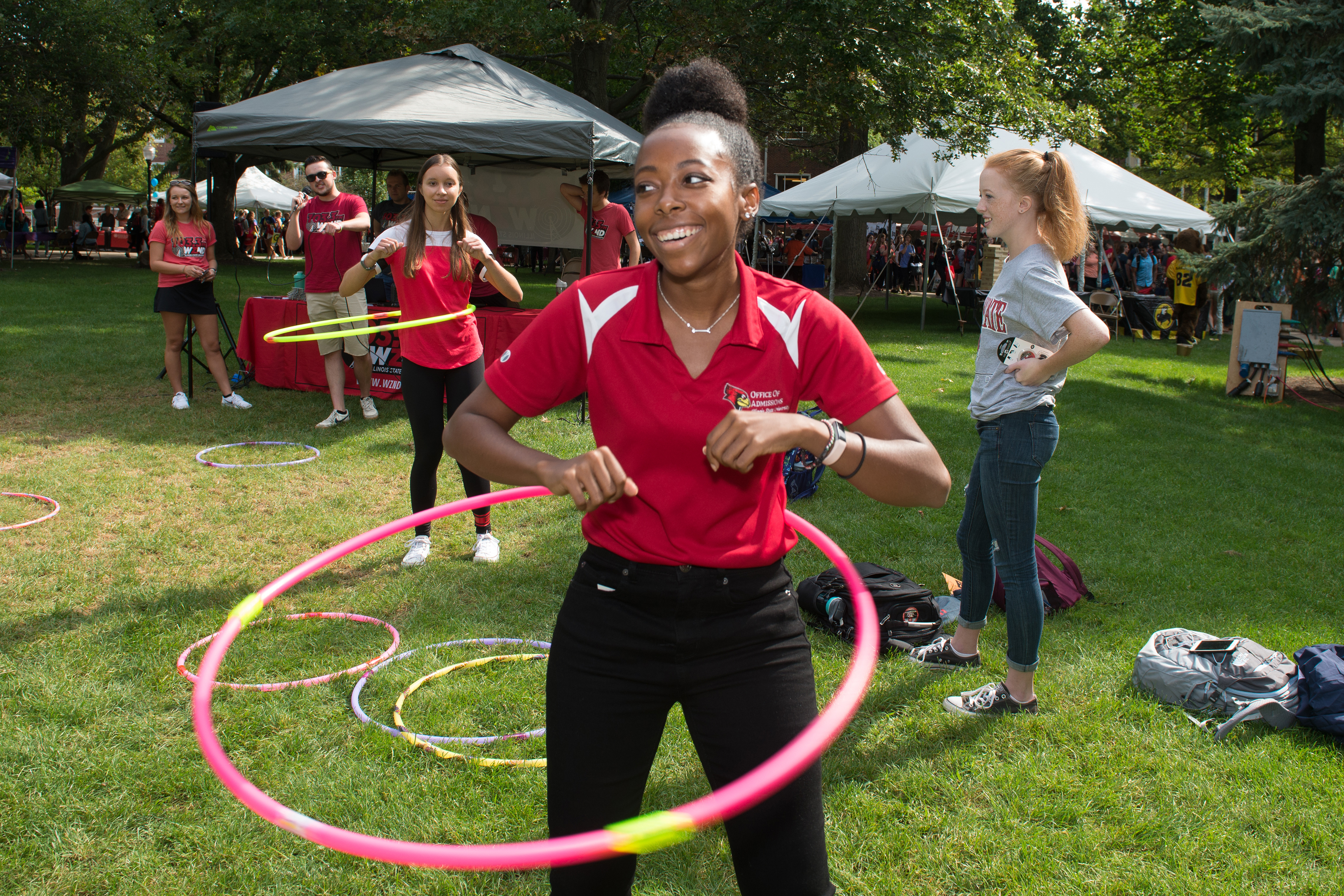 ISU students hula hoop outside at ISU Fest
