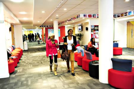 International students walking through INTO Centre breakout space