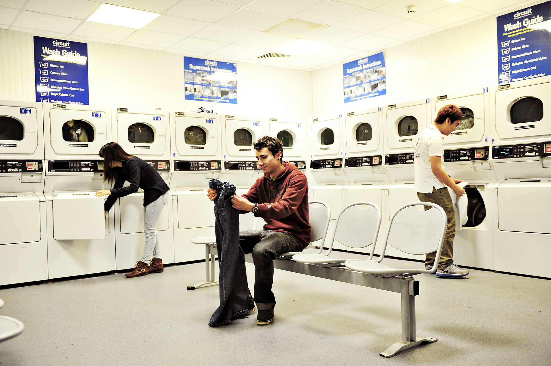 Students using shared laundry facilities in Elms BT9 student residences