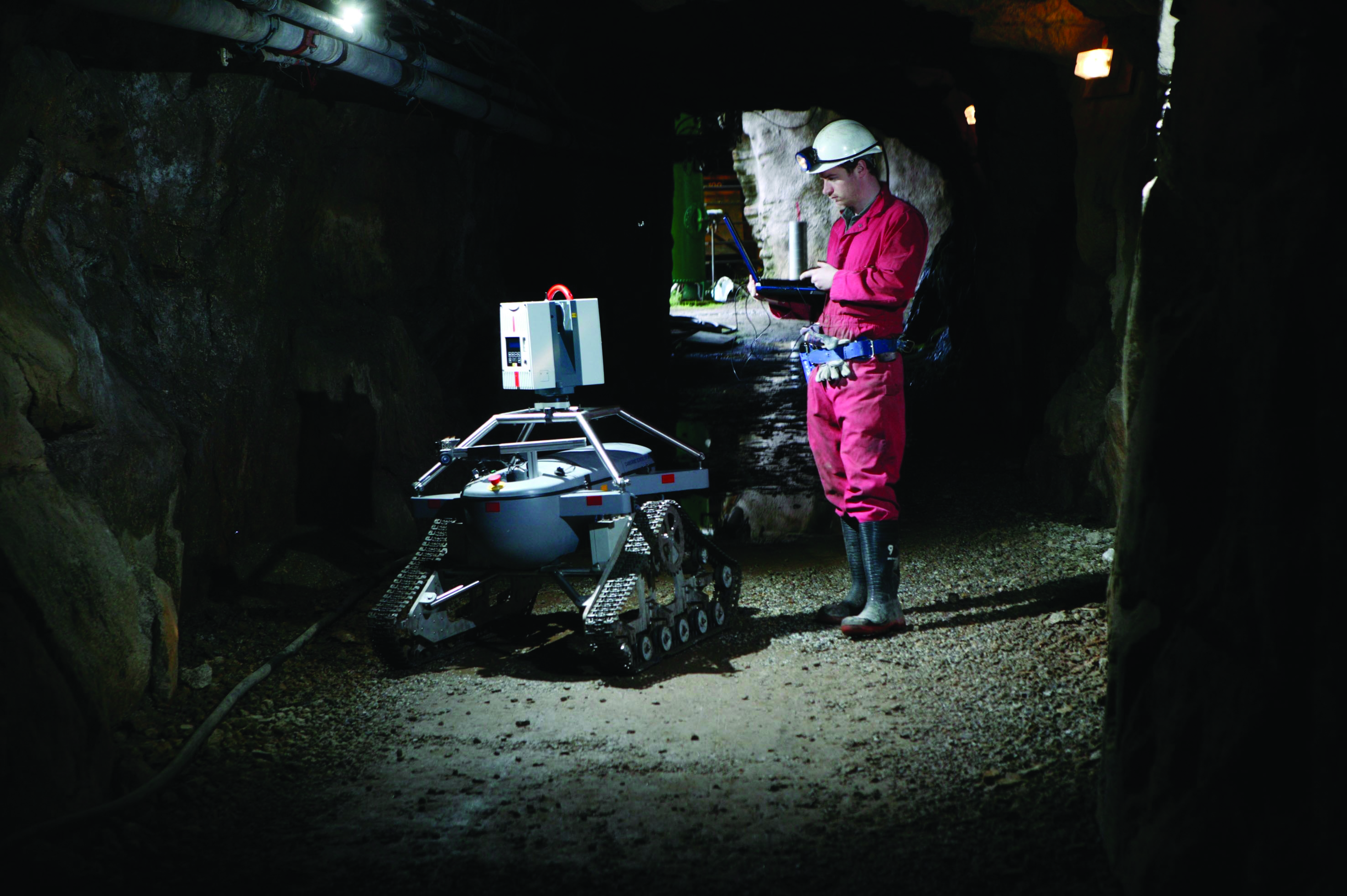 Students uses robot to survey rocks in mine