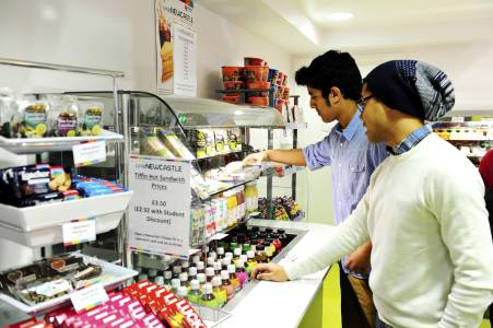 International students choosing food in INTO Centre cafe