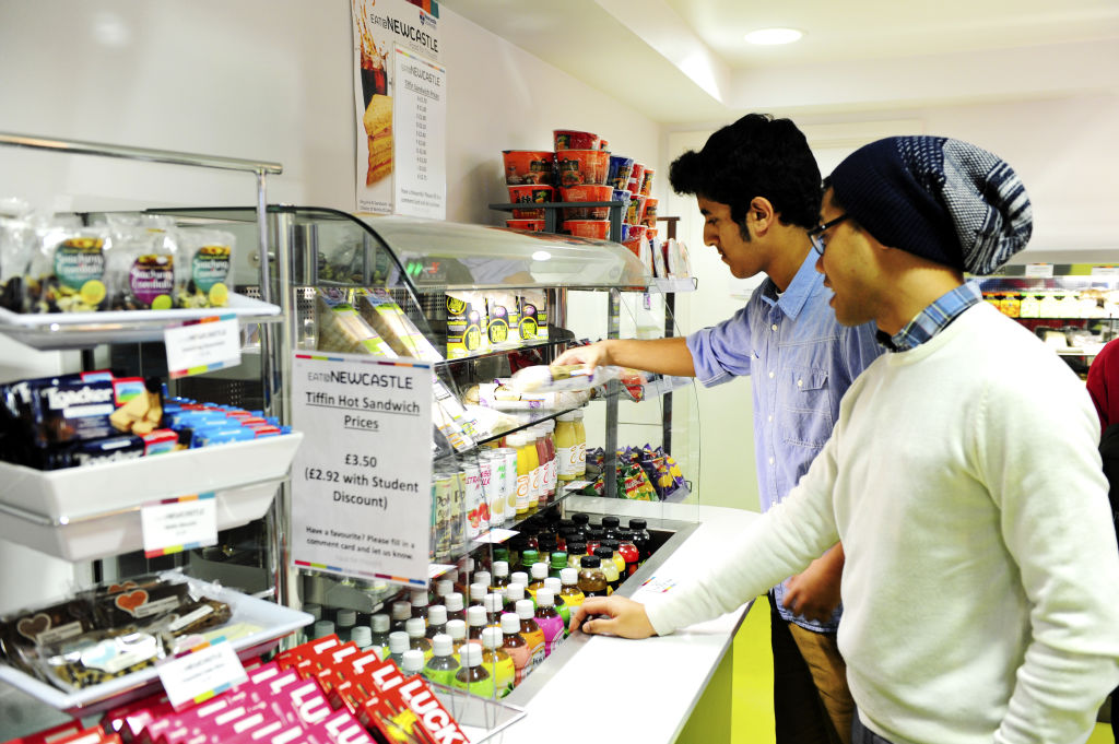Students choosing food in the INTO Centre cafe