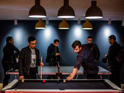 Students playing pool at Scape East student residences