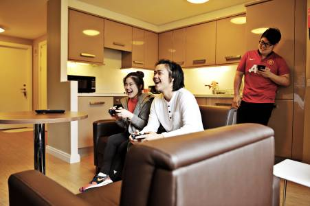 International students socialising in shared kitchen and social spaces in Elms BT9 student residences