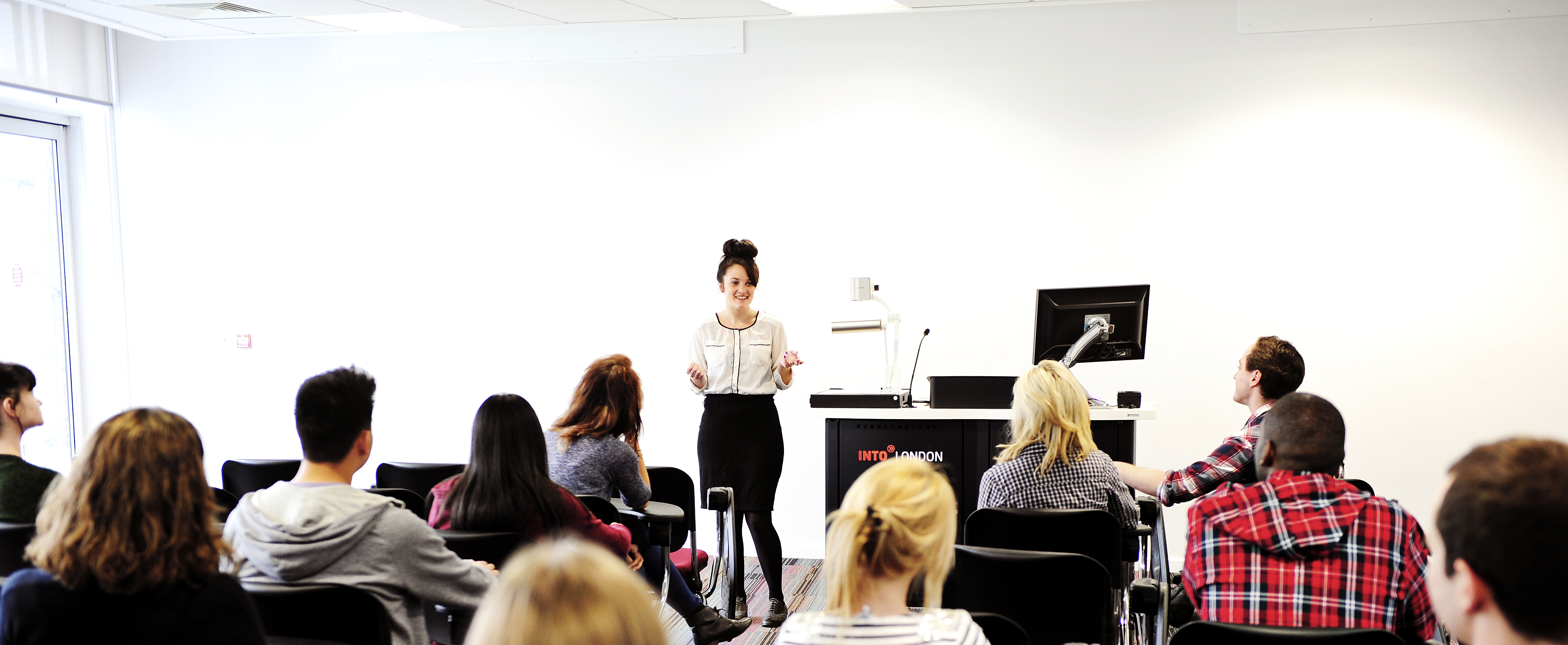 Image of classroom with teacher and international students