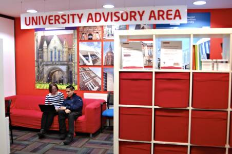 University advisory area in centre with staff helping international student