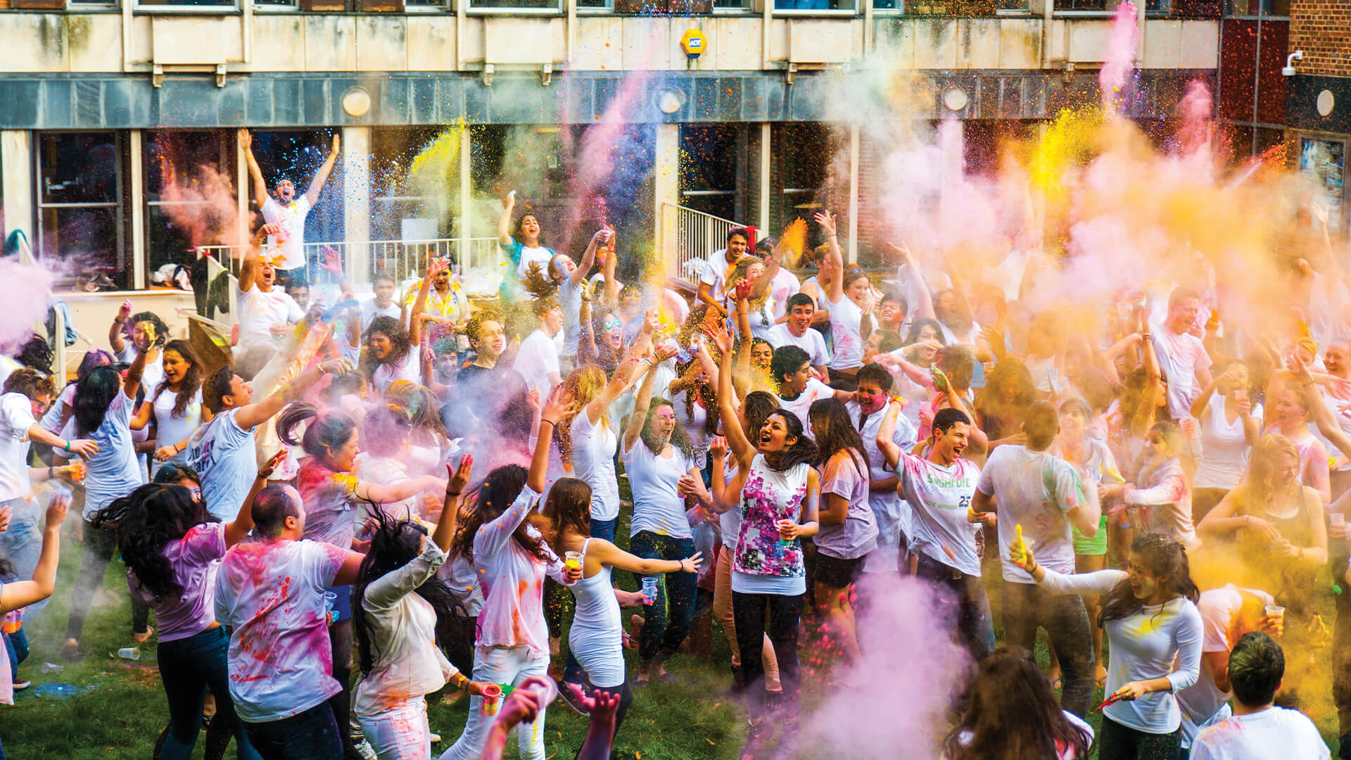 Students taking part in Holi celebrations at University of Exeter campus