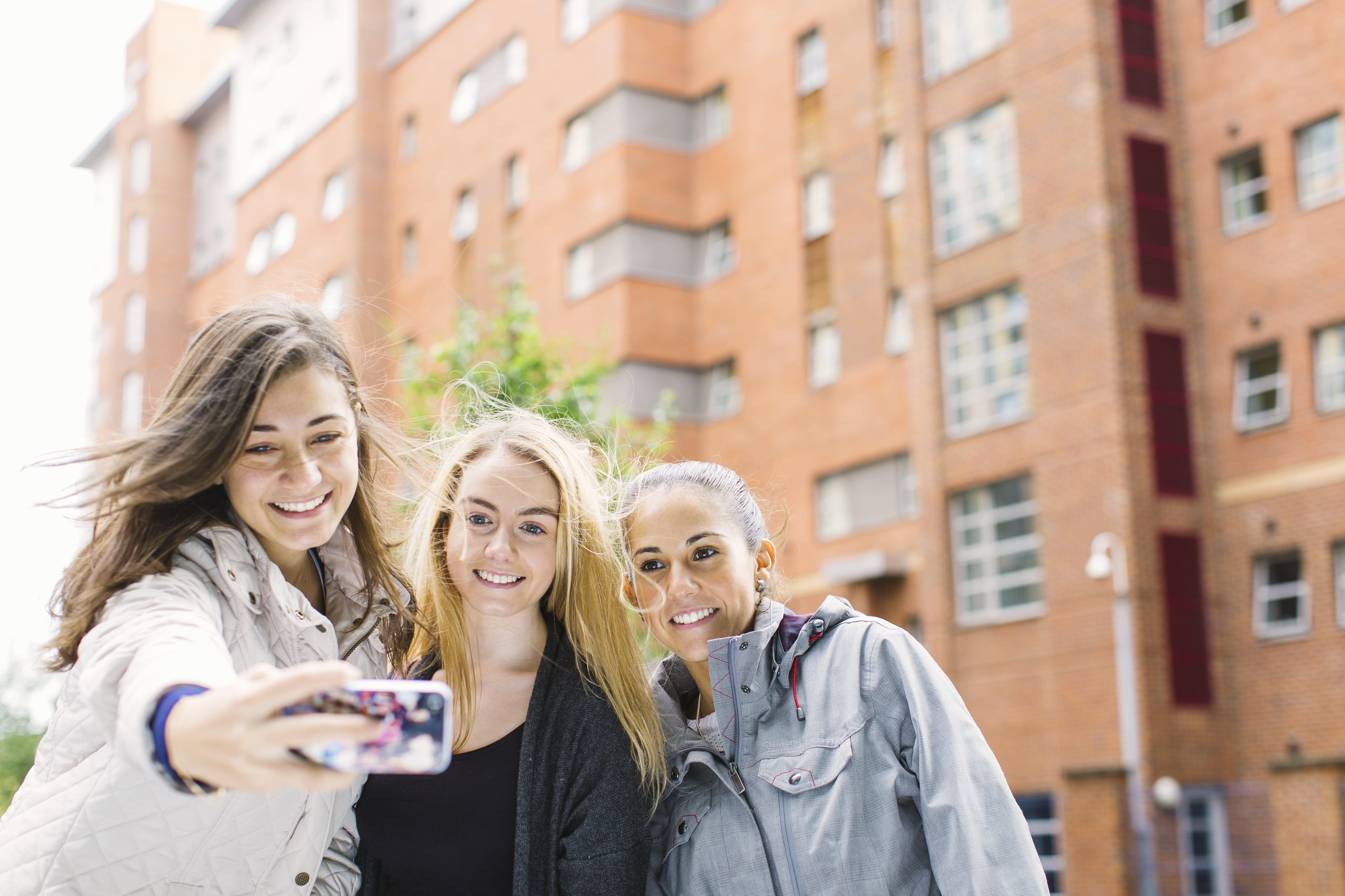 Students outside the INTO Manchester accommodation