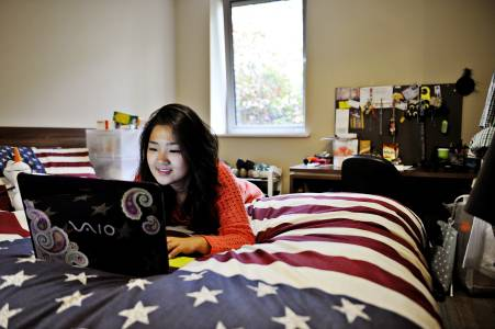 Student using a laptop in their room at Willow Walk student accommodation