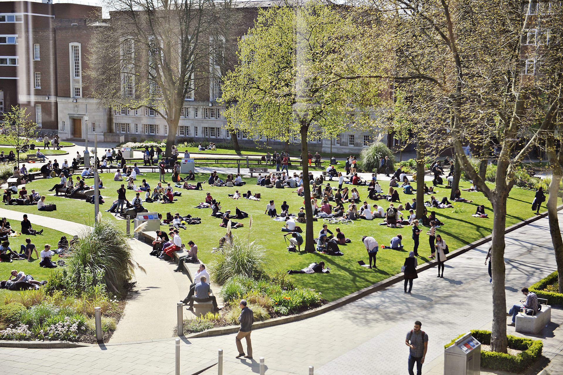 Students relaxing outside on campus at The University of Manchester
