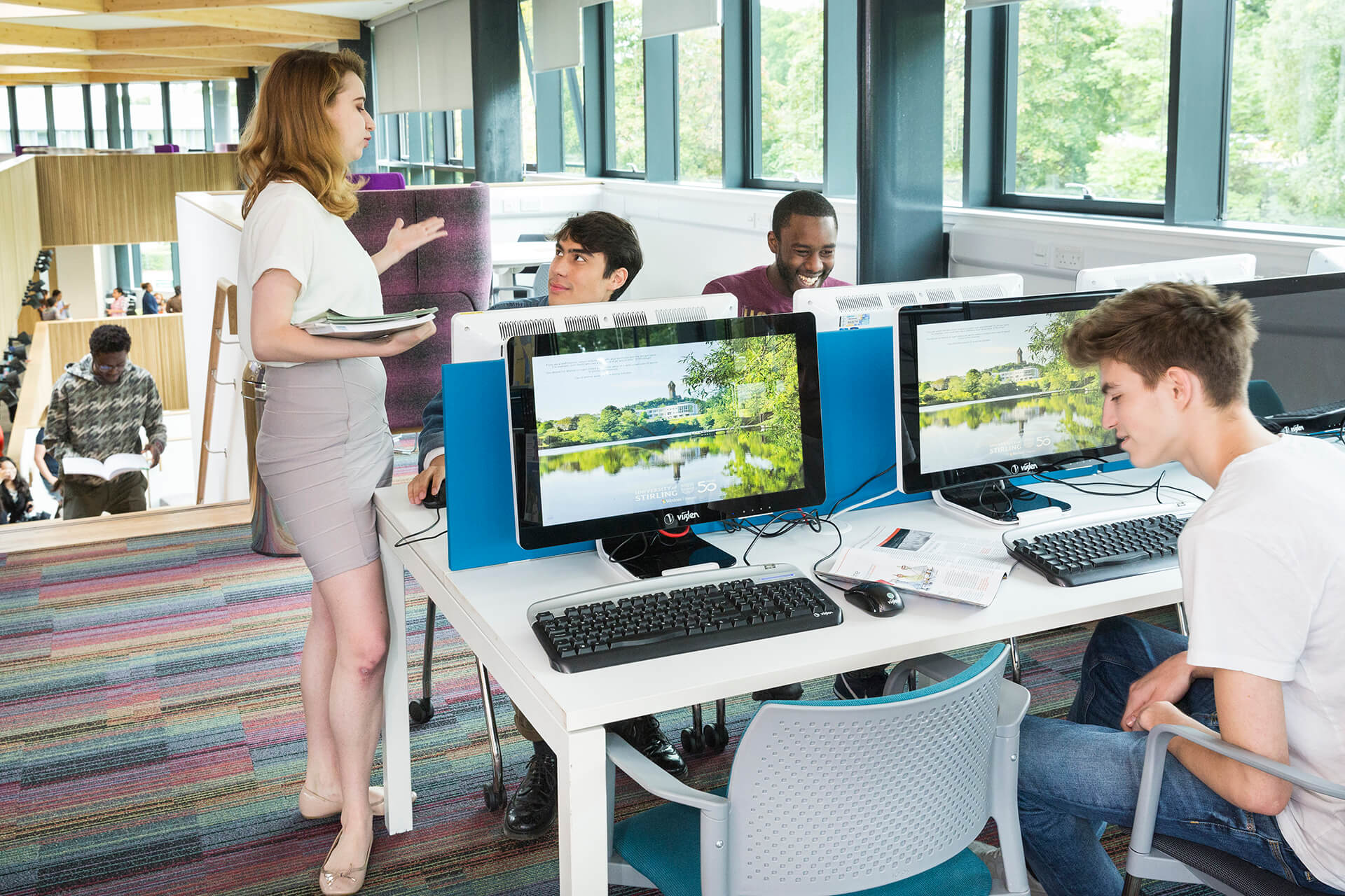 Students studying on computers in INTO Stirling's Learning Resource Centre