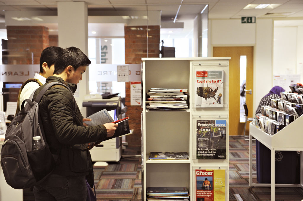 Students looking at magazines in the Learning Resource Centre
