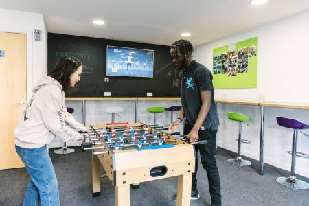 International students playing table football in Liberty Point breakout area