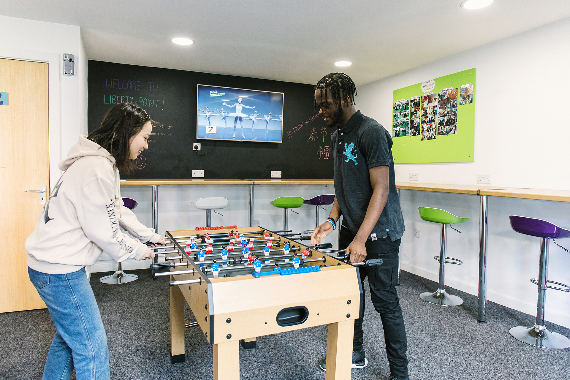 International students playing table football in the breakout area